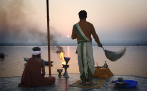 Priest saluting the sun in the Ganges, Varanasi Benares India